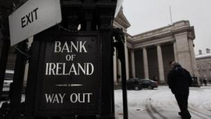 "The Irish Republic's exit from its bailout rescue is a ""milestone"" but not the end of the road, the country's finance minister says."