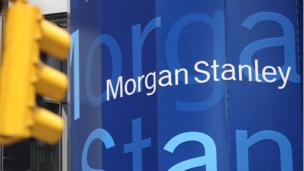 US banking giant Goldman Sachs reports a drop in net earnings while Morgan Stanley sees profits jump.
