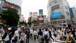 Japan revises down its growth data for the July-to-September period after private investment slowed more than expected.