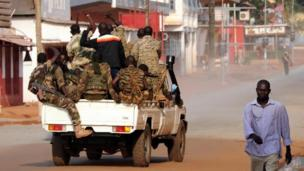 At least 80 people are reported killed in the latest violence in the Central African Republic as the UN votes to allow France to join a peacekeeping force.