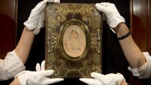 "A painting described as the ""most famous image"" of Jane Austen is sold at auction for £164,500."