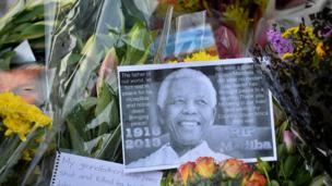 "Tens of thousands join world leaders at a rainswept memorial for South Africa's Nelson Mandela, with Barack Obama hailing him a ""giant of history""."