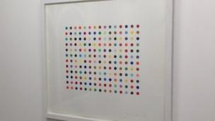 Two signed Damien Hirst art works worth £33,000 are stolen from a London gallery.
