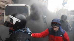 Pro-EU protesters in the Ukrainian capital, Kiev, push back riot police from their protest bastions as the interior minister promises not to use force.