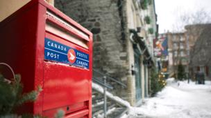 Canada Post says it will phase out home delivery in urban areas over the next five years as the postal service struggles to rein in persistent losses.