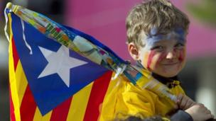 Parties in the Spanish region of Catalonia agree to hold a referendum on independence next year - but the Spanish government vows to block it.