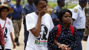 Nelson Mandela's period of lying in state ends with mourners rushing past police, eager to join the tens of thousands who have filed past his body since Wednesday.