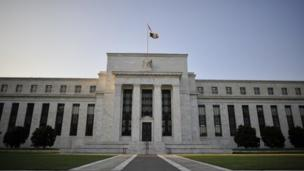 The US Federal Reserve announces plans to slow its stimulus effort by $10bn (£6.1bn) a month in a sign that the central bank believes the world's biggest economy has strengthened.