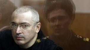 Russian President Vladimir Putin says he will soon pardon jailed ex-oil tycoon Mikhail Khodorkovsky, but it is unclear whether he asked for clemency.