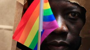 Uganda's parliament passes a bill to toughen the punishment for homosexual acts to include life in jail and force people to report gay activities.