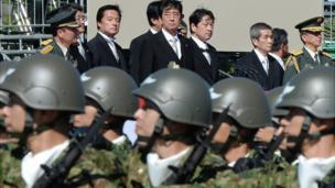China accuses Japan of using concerns about its national security for military expansion, days after Tokyo announced a rise in defence spending.