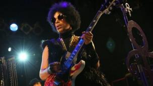 Pop star Prince signs a major deal with Warner Bros Records, the label he famously fell out with nearly 20 years ago.