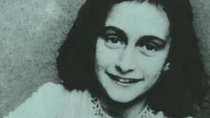 Police in Japan arrest a man suspected of vandalising copies of Anne Frank's diaries and related material.