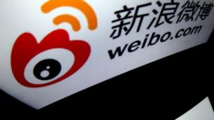 Shares in China's largest Twitter-like service, Weibo, went up by almost 20% on the first day of its listing in the US, despite a disappointing start.