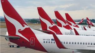 Australia's national flag carrier Qantas reports a net loss of A$2.8bn for the year ending in June - a record annual loss for the airline.