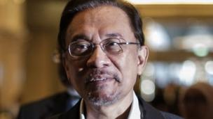 A Malaysian court overturns the acquittal of opposition leader Anwar Ibrahim on sodomy charges, upholding a government appeal.