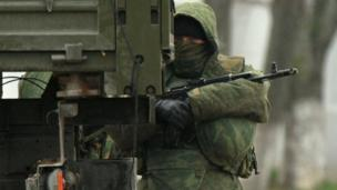 There is reportedly a stand-off between Ukrainian troops and what are thought to be Russian soldiers at a military base near the Crimean city of Sevastopol.