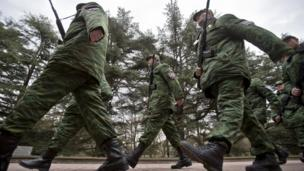 Warning shots are fired as international observers are turned back from entering Crimea where pro-Russian forces have tightened their grip.