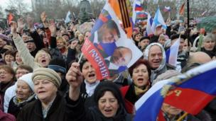 Pro-Ukrainian activists are beaten up by pro-Russian groups at a rally in Crimea amid high tension ahead of next Sunday's secession referendum.
