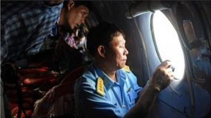 Vietnamese planes spot possible debris from the missing Malaysia Airlines jet - nearly two days after it disappeared with 239 people on board.