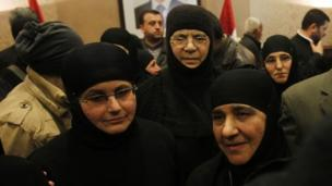 A group of Greek Orthodox nuns held for three months by rebels in Syria after being taken from their convent in Maaloula arrive back in Damascus.