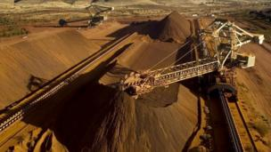 Shares of some of the world's biggest mining companies are hit by a slump in the price of iron ore, amid fears of a Chinese economic slowdown.
