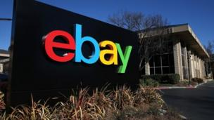 E-commerce giant eBay cuts the total compensation of its chief executive, John Donahoe, by more than half.