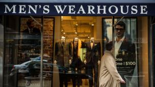 Men's Wearhouse agrees to buy rival Jos A Bank for $1.8bn (£1.1bn) ending a takeover battle between the two rivals that had lasted for months.