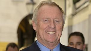 "Broadcaster Chris Tarrant had a ""mini-stroke"" while flying from Bangkok to London earlier this month from which he is now recovering in hospital, his manager confirms."