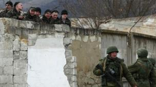 Russia begins new military exercises, involving more than 8,000 troops and large artillery, close to Ukraine's borders.