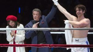 'Stage magic' triumphs over lacklustre music to win critics approval as big screen hit Rocky opens on Broadway