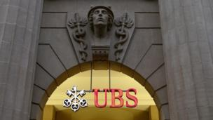 Traders at Swiss bank UBS made around 100 attempts to rig Hong Kong's interbank lending market, financial regulators have said.