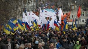 Thousands of people attend a rally in Moscow to oppose Russian intervention in Ukraine, a day before Crimea votes to secede to join Russia.