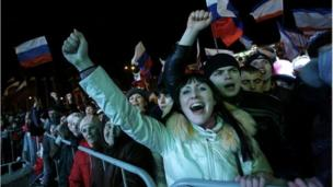 More than 90% of voters in Crimea back leaving Ukraine, exit polls say, and Crimea's leader says a formal request to join Russia will be made on Monday.