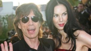 L'Wren Scott, a 49-year-old fashion designer and girlfriend of Sir Mick Jagger, is found dead in her New York City flat in an apparent suicide.
