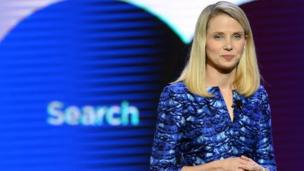 Shares in the struggling internet search giant Yahoo surge 9%, despite first-quarter profits falling 20%.