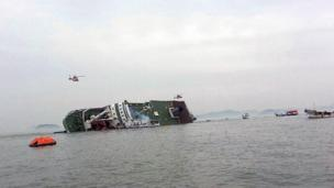 Almost 300 people remain unaccounted for after a ferry carrying 459 people capsized and sank off South Korea, officials say.
