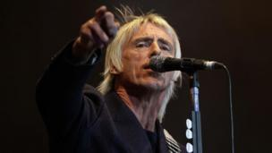 "Rock star Paul Weller wins £10,000 for his children after their pictures were ""plastered"" on the Mail Online."
