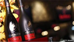 French spirits firm Remy Cointreau says operating profits will fall by up to 40% after a crackdown by China on extravagant spending hits sales.