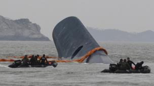 The third officer was at the helm of the ferry that capsized off South Korea, investigators say, as divers work to access the sunken hull.