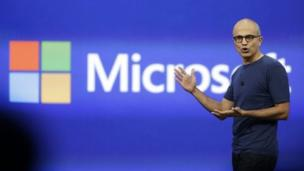 Microsoft earnings decline to $5.66bn, but beat market estimates as new chief executive Satya Nadella's push into cloud computing pays off.
