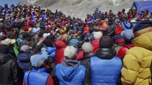 Climbers are descending from Everest base camp, amid considerable uncertainty over this year's climbing season after a deadly accident killed 16 sherpa guides.
