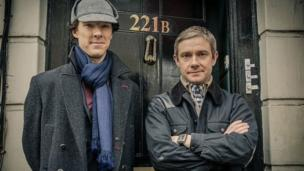 BBC One drama Sherlock wins a hat-trick of awards at the Emmy Awards in Los Angeles, including prizes for Benedict Cumberbatch and Martin Freeman.