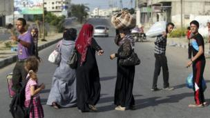Thousands of Palestinians flee northern Gaza after Israeli warnings, on the sixth day of air strikes aimed at stopping rocket attacks.