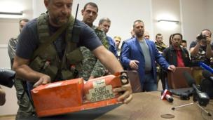 Rebels in eastern Ukraine have handed over two flight-data recorders from the downed MH17 plane to Malaysian officials.