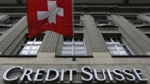 Swiss banking giant Credit Suisse reports its biggest quarterly loss in almost six years after being hit by its settlement with US authorities over tax evasion charges.