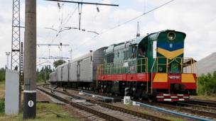 A train carrying the remains of most of the victims of the MH17 plane crash arrives in the Ukrainian city of Kharkhiv, out of rebel-held territory.