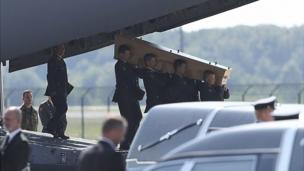 The Netherlands receives the first victims' bodies from crashed Malaysia Airlines flight MH17 in a solemn ceremony at Eindhoven air base.