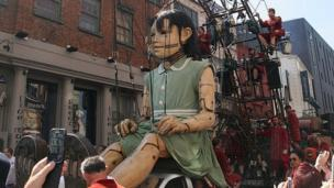 Thousands of people line Liverpool's streets to welcome three giant marionettes which will tell the story of the city during World War One.