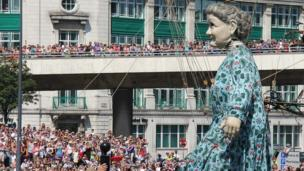 An estimated 100,000 people line Liverpool's streets to welcome three giant marionettes which will tell the story of the city during World War One.